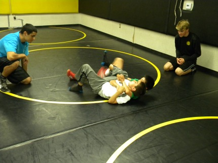 Geoff and Michael work  with some of the youth on a cradle.